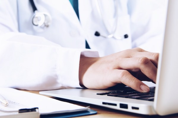 Physician using laptop